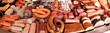 Leinwanddruck Bild - Gefüllte Wursttheke in einem Geschäft
