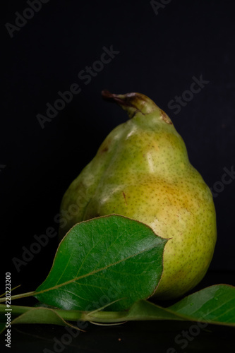 Fresh ripe organic pear on dark background, diet food