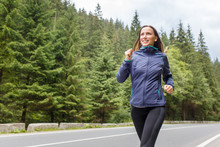 Young Smiling Woman Jogging On...