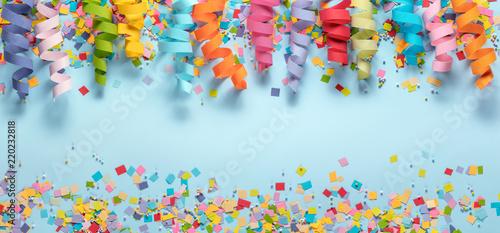 Obraz Streamers and confetti on blue background.Birthday decoration. - fototapety do salonu
