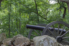 Civil War Cannon Behind A Stone Wall