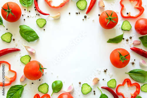 Fotobehang Groenten Colorful salad ingredients pattern made of tomatoes, pepper, chili, garlic, cucumber slices and basil on white background. Cooking concept. Top view. Flat lay. Copy space