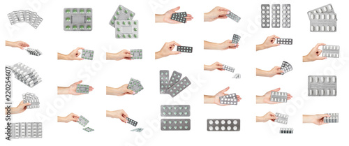 Fotografija set of different Silver blister packs pills with hand isolated on white background