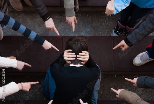 Photo  a lonely sad kid being bullied from his mates