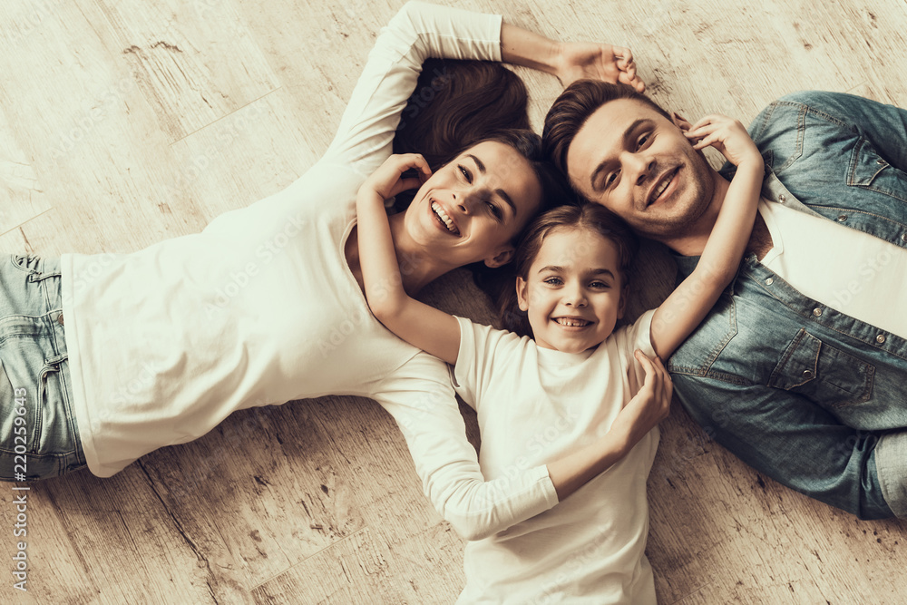 Fototapety, obrazy: Happy Family Lying of Floor Together at Home
