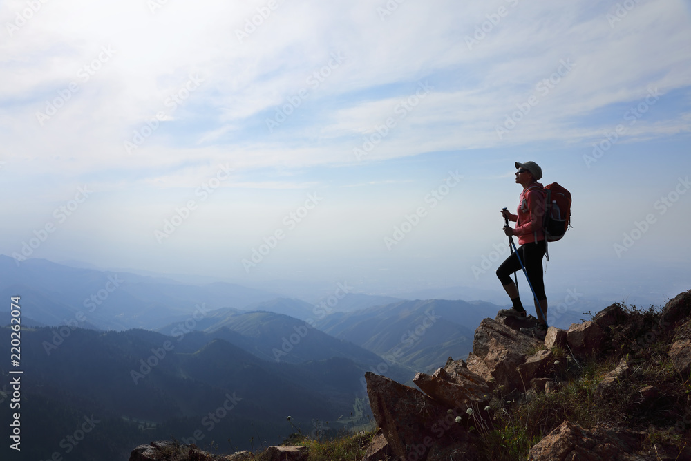 Fototapety, obrazy: Lady hiker with backpack standing on top of the mountain