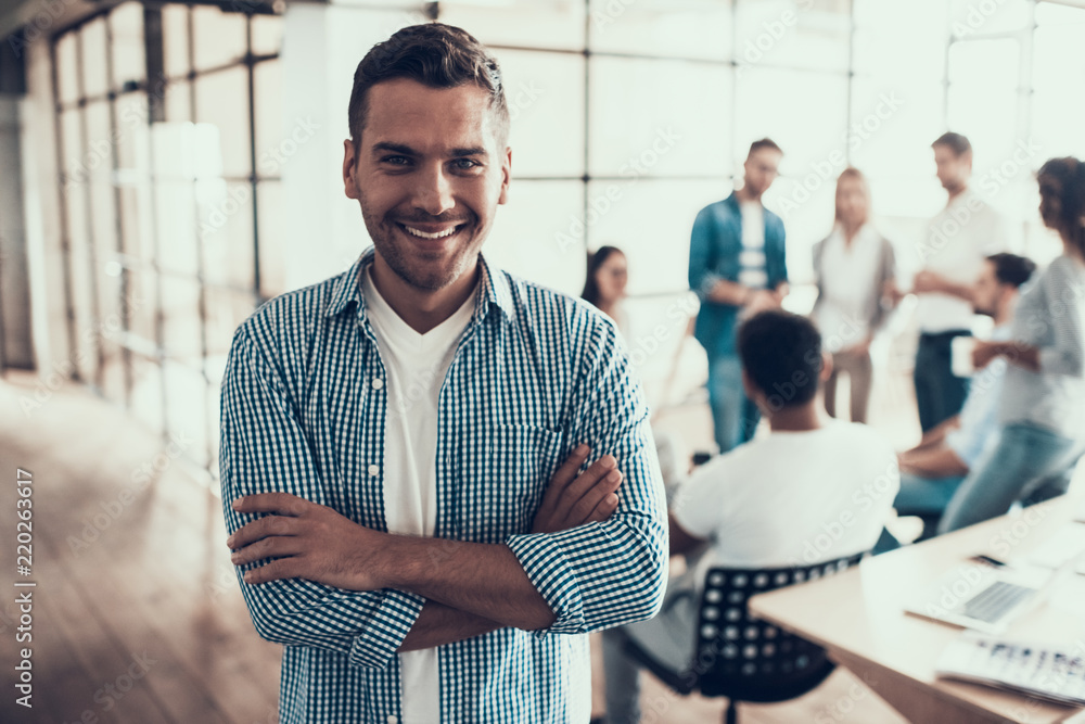 Fototapeta Portrait of Young Smiling Businessman in Office