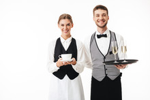 Young Cheerful Waiter Holding ...