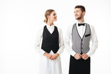Young Smiling Waiter And Prett...