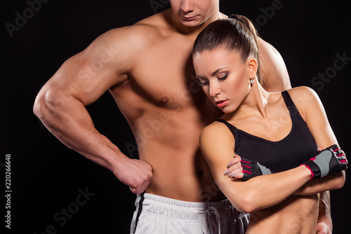 Spoed Foto op Canvas Fitness Lean girl and huge athlete.
