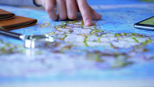 Man Studying Africa Continent On Map, Choosing Travel Destination For Vacation