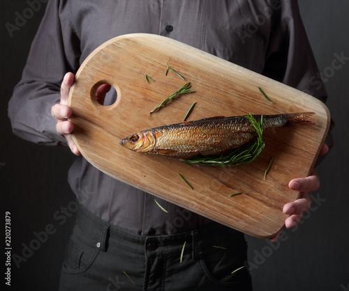 Man with smoked herring .