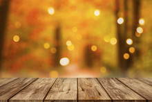 Wooden Table With Blurred Autumn Forest Background