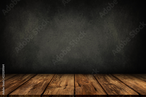 Fototapeta wooden table with grey wall background obraz