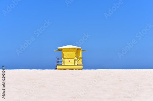 Tuinposter Canarische Eilanden Yellow Lifeguard hut on Corralejo Beach in Fuertevantura Island, Canary Islands, Spain