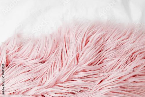 Fotografie, Obraz  Bedding with a pink fluffy fur plaid