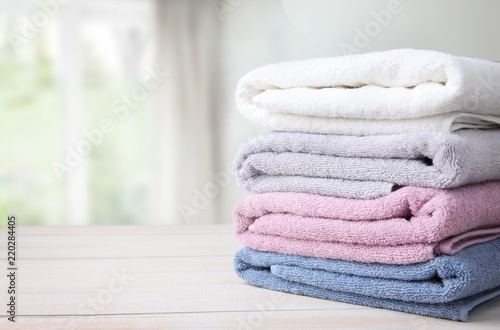Foto Towels stack on table empty space background.