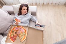 Woman Eating Pizza Image Taken...