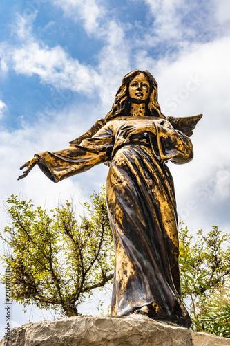 A bronze statue of an angel in Santa Maria di Leuca Canvas-taulu
