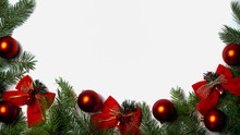View From Above On Christmas And New Year Background With Green Branches Of Fir Tree Red Glass Balls And Red Bows Bells On White Background. Copy Space. Horizontal.