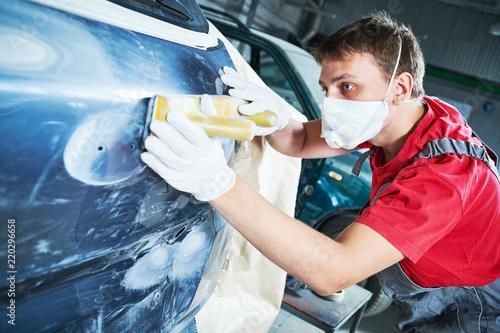 auto repairman grinding automobile body Wallpaper Mural