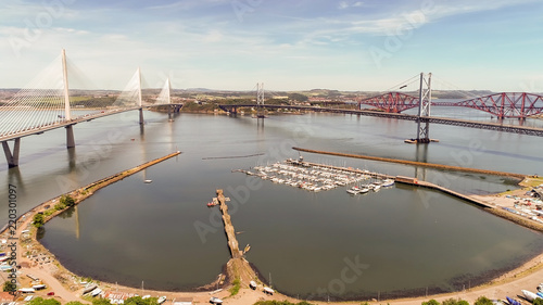 Aerial image looking over the marina at South Queensferry to the Forth road and rail bridge and new Queensferry Crossing.