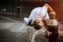 Man Dropping Fresh Water On His Head With Fire Hydrant Water