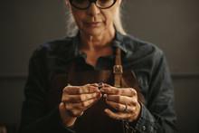 Woman Goldsmith Inspecting Sil...