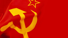 Communism And Marxism Concept With Close Up On The Hammer And Sickle From The Flag Of The Old Union Of Soviet Socialist Republics (USSR Or Soviet Union) With A Wave And Copy Space