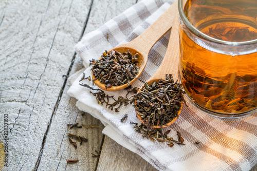 Black tea in glass cup, closeup