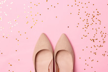 Female Shoes With Heels And Shiny Confetti On A Colored Background. Women's Shoes.