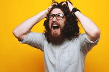 Young Bearded Man In Shirt Screaming
