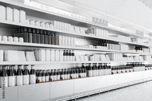 Fotografia Supermarket shelves with mock up goods
