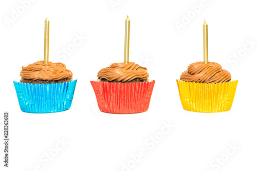 Chocolate cupcakes with gold candles  isolated on white background Canvas Print