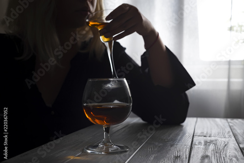 Woman drinking alcohol alone looking out her window Canvas Print