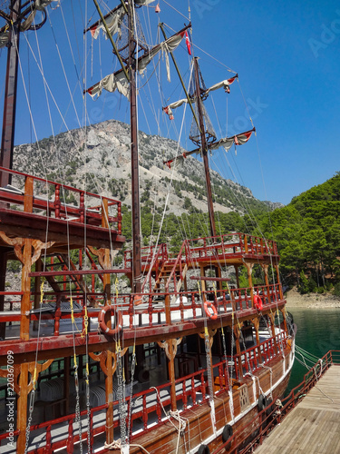 Keuken foto achterwand Schip Old abandoned wooden sailing ship on the background of the mountain