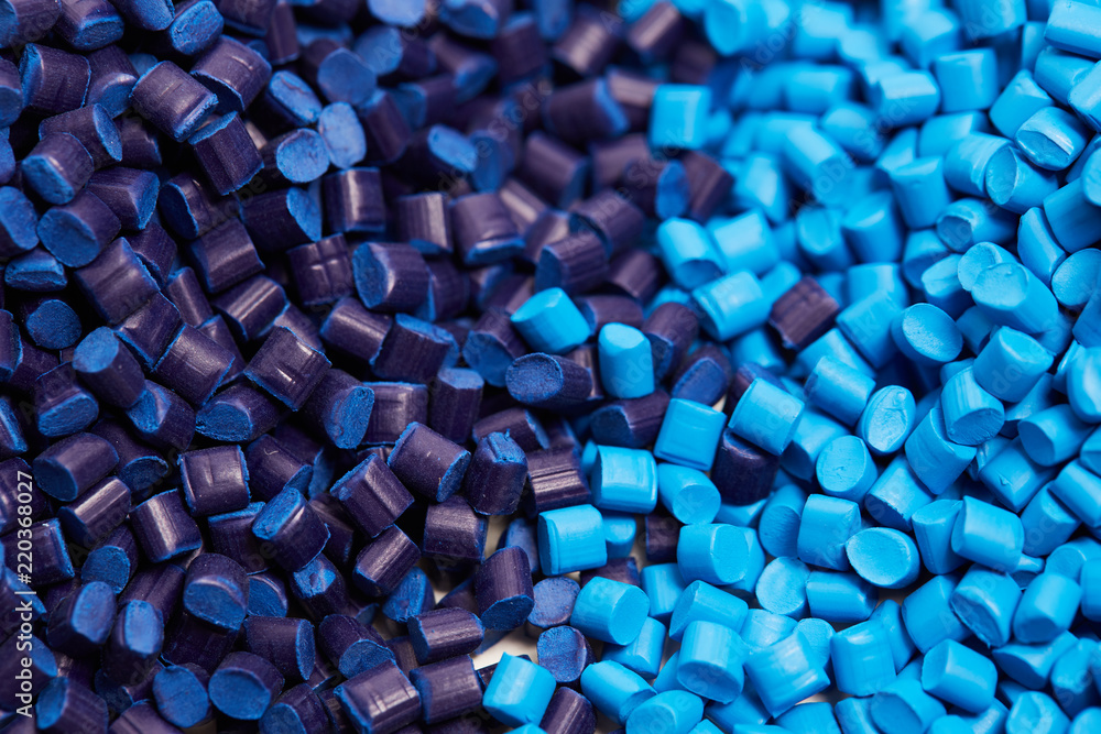 Fototapety, obrazy: Close up of a two stacks of blue plastic polypropylene granules on a table