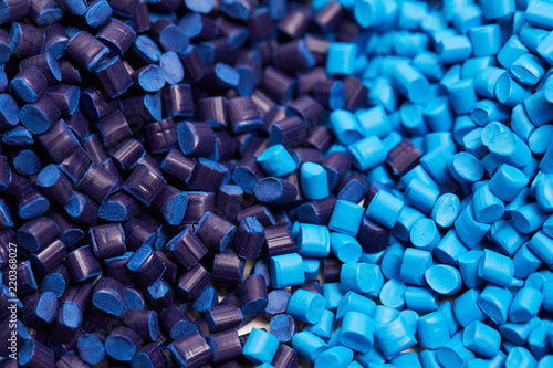 Fotomural  Close up of a two stacks of blue plastic polypropylene granules on a table