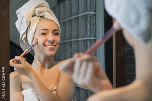 blonde girl putting on makeup Canvas Print