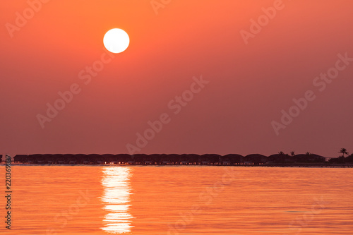 Golden sunset over holiday villas - Buy this stock photo and explore