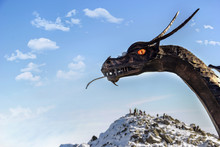 Iron Dragon Over The Sky And Mountains. Background