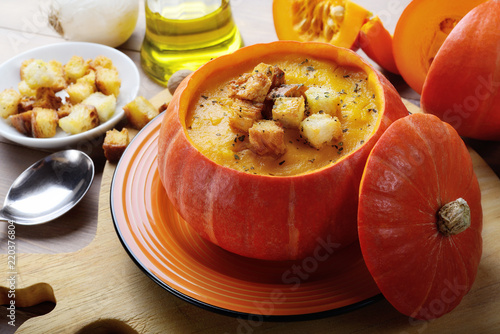 Pumpkin soup with croutons in pumpkin bowl