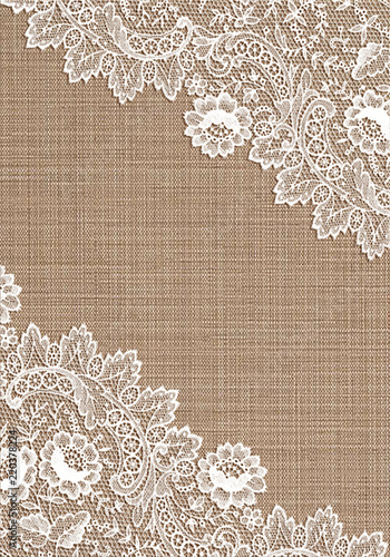 Leinwand Poster Old lace corner on  cloth background