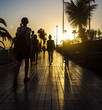 people walking on sunset street