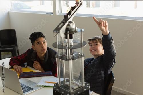 Kids discussing over machine in the training institute
