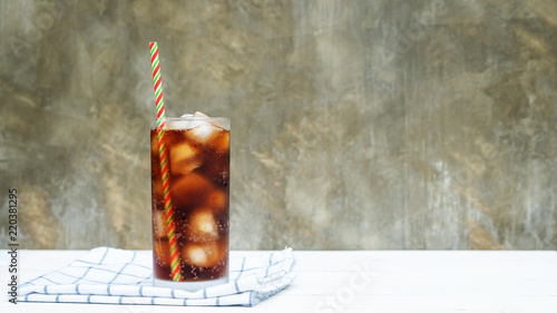Iced aerated soft drink on a white wooden table. Canvas Print