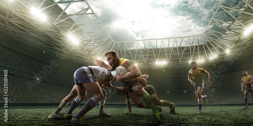 Rugby players fight for the ball on professional rugby stadium Fototapet