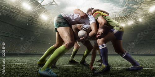 Fotografiet  Rugby players fight for the ball on professional rugby stadium