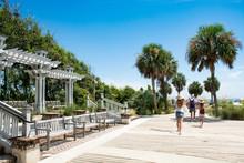 Family Walking To The Beach On Summer Vacation. Coligny Beach Park, Hilton Head Island, South Carolina, USA