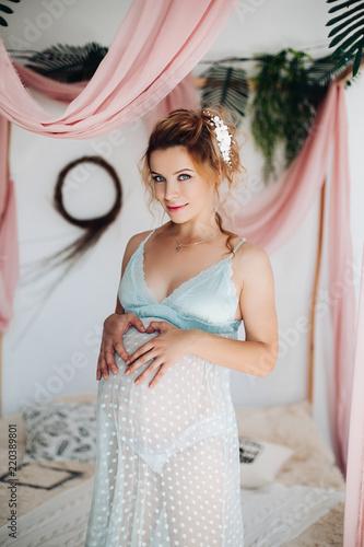d371e68b25c Beautiful blonde woman in pregnant